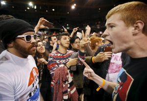 A Trump supporter (R) yells at a demonstrator (L) after Republican U.S. presidential candidate Donald Trump cancelled his rally at the University of Illinois at Chicago March 11, 2016. REUTERS/Kamil Krzaczynski TPX IMAGES OF THE DAY - RTX28SP3